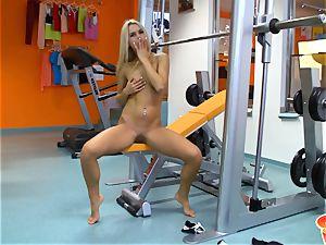 Sabrina platinum-blonde diddling her cunt at the gym