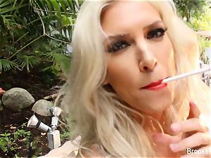 blond sweetie Brooke smokes and milks outdoors