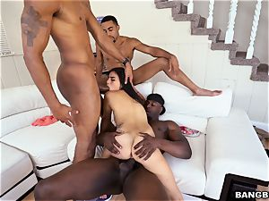 Michelle Martinez getting poked by a fountain of dark-hued sausages