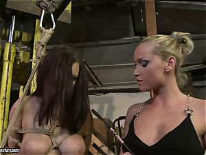Kathia Nobili slapping the caboose of super-steamy female with flog