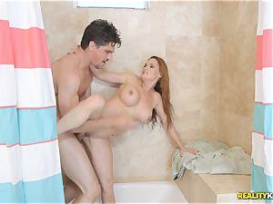 mummy Diamond Foxxx deep throats pipe inbetween the shower curtain
