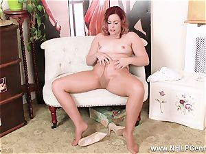 English ginger-haired rips open shiny nude stockings to masturbate